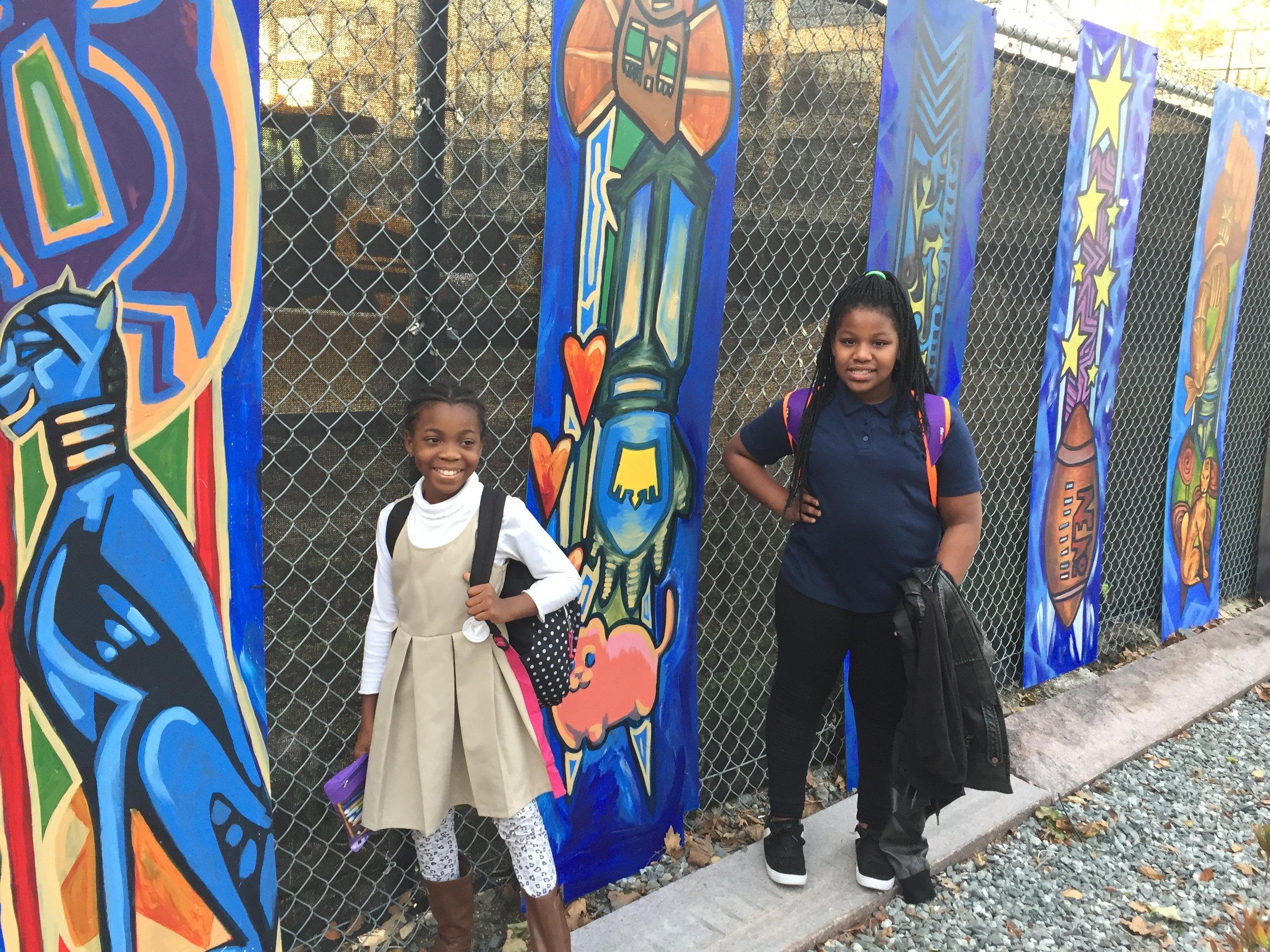 3rd & Binney - Totem Artists from the Community Art Center