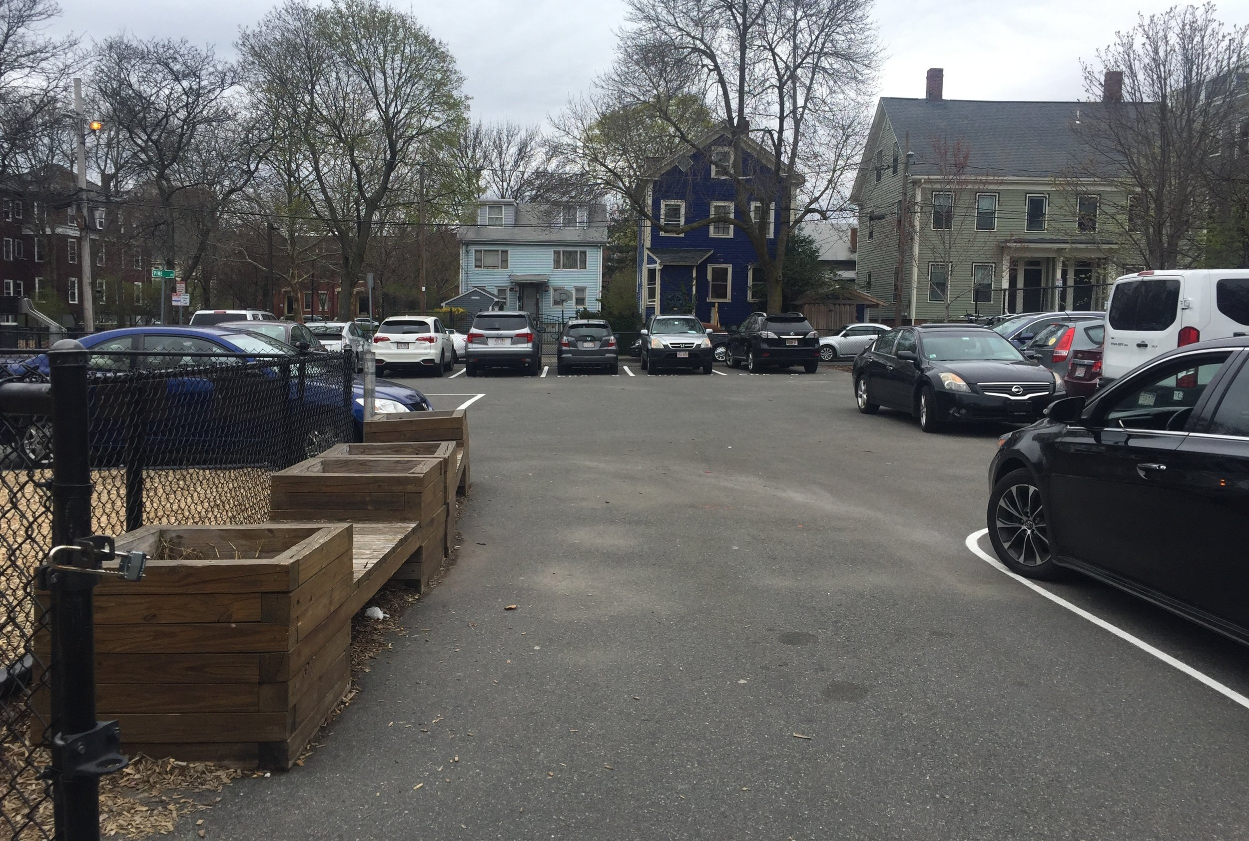 View of rear parking lot from back of historic house. The homes across from the far end of the lot are on Pine Street.