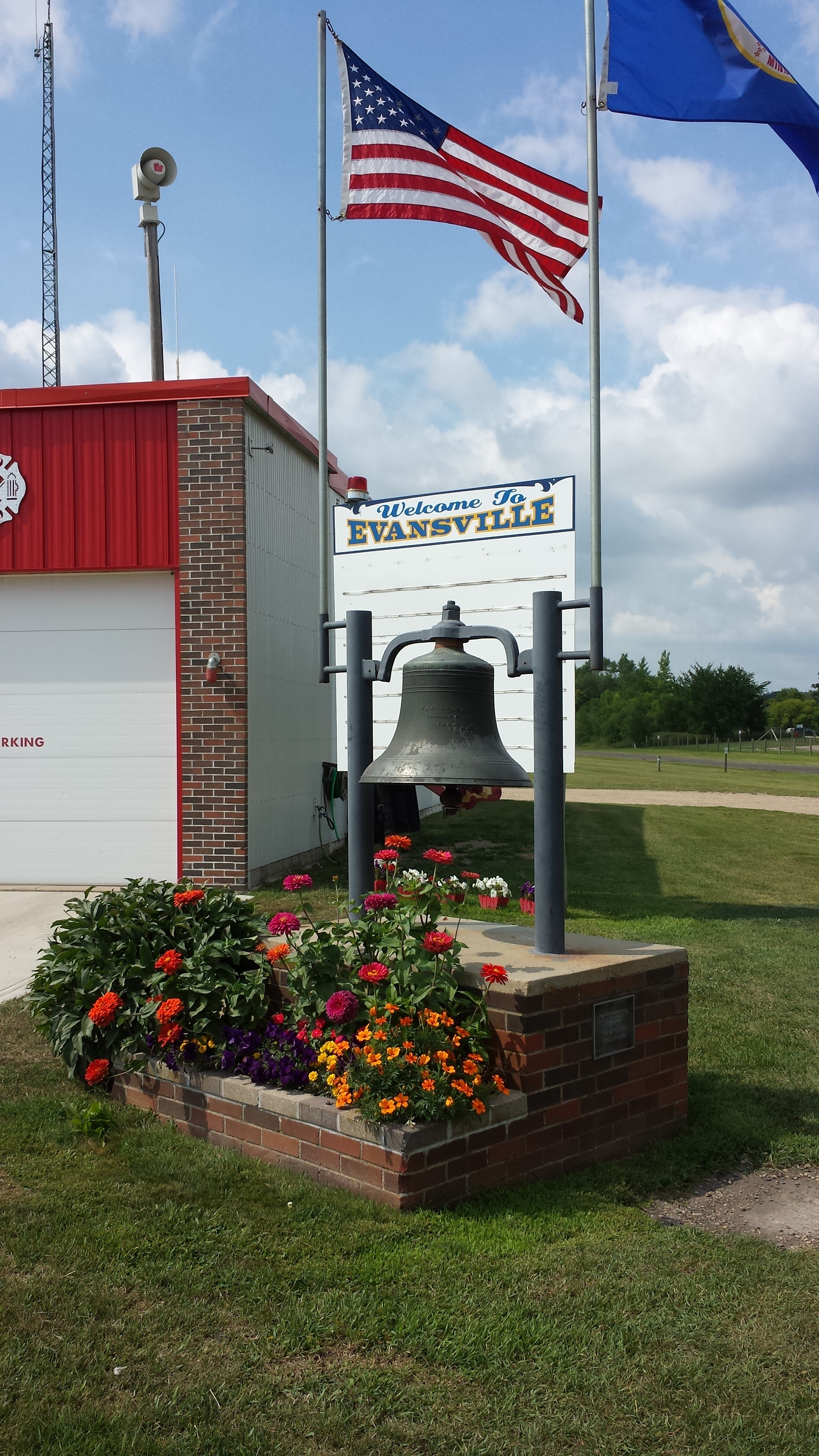 Flowers complete a new planter in front of the community billboard in Evansville.