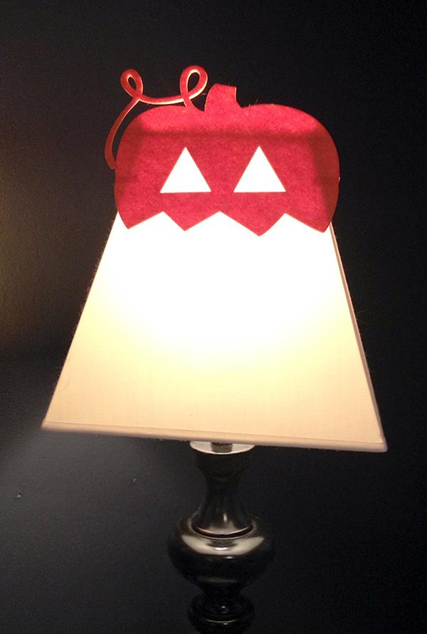 Halloween felt mask tops a simple lamp shade