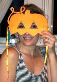 betsy behind her jack-o-lantern felt mask