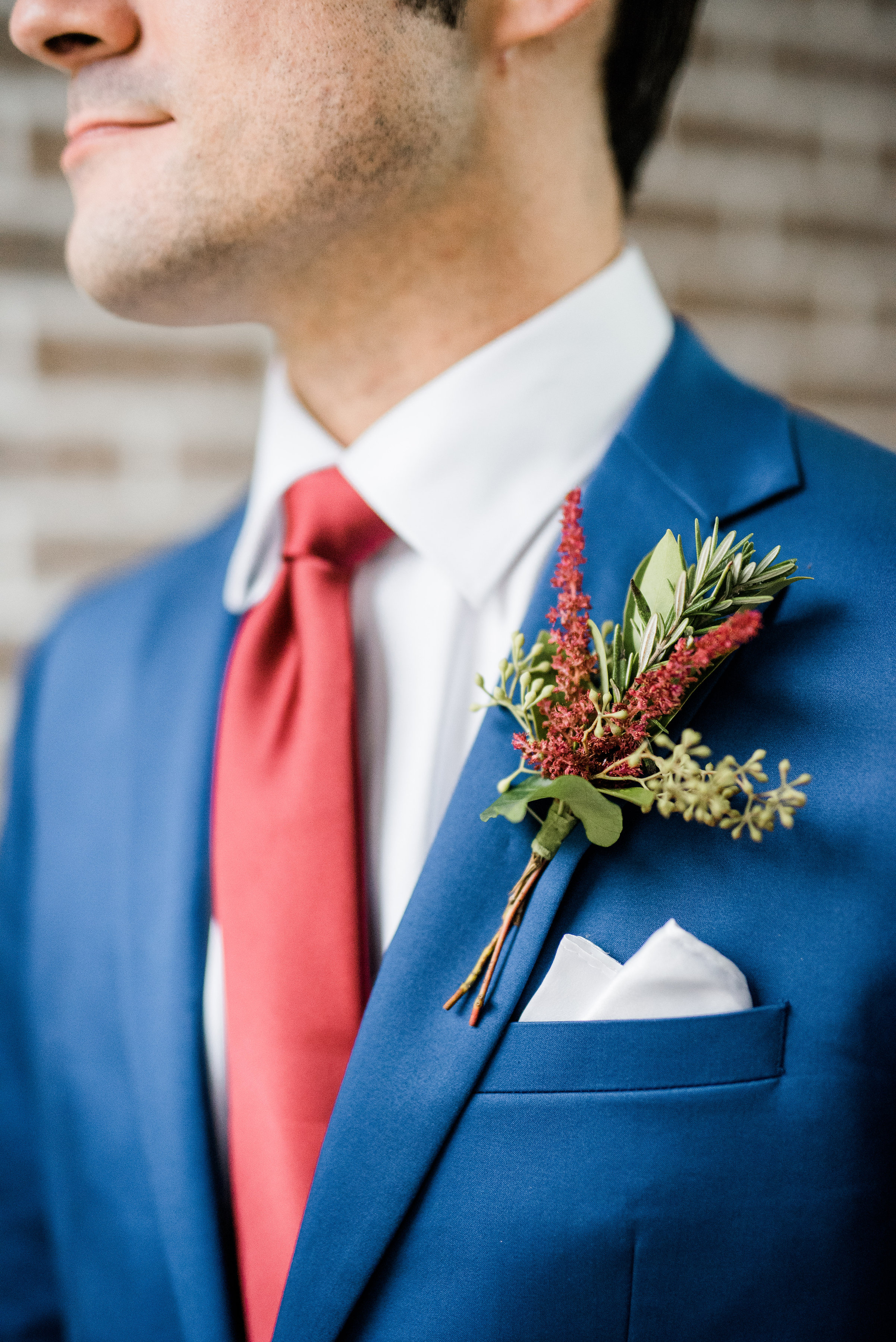 Boutonnieres are fun because you can make them match with the bridesmaids bouquets and use them to bring out fun accent colors of your color scheme.