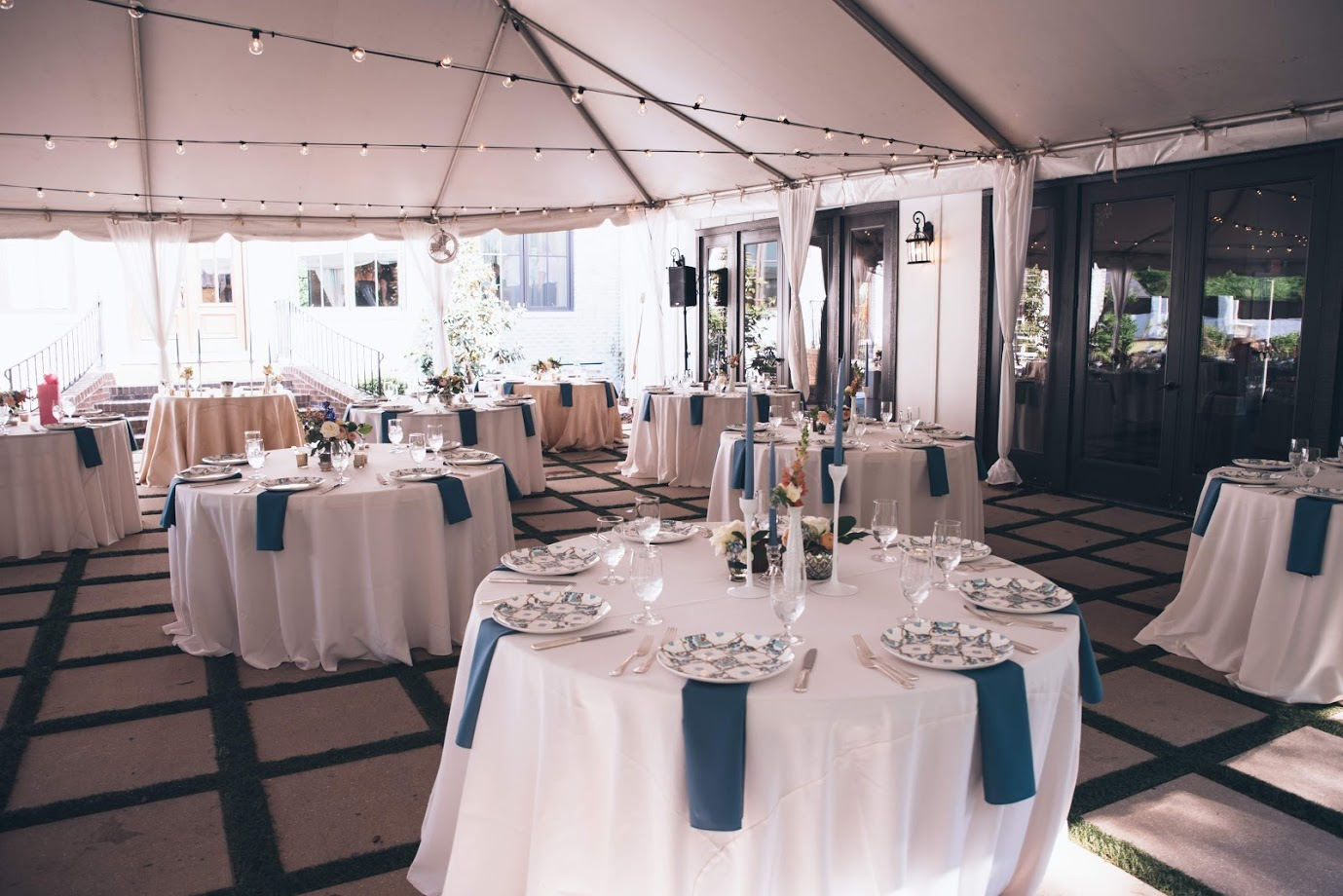 Photo by Three Regions Photography  40 x 40 White top with pole drapes and guttered to Ballroom doors through CE Rentals
