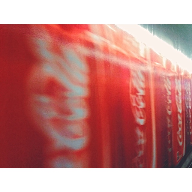 Trippy blurred Coca-Cola hallway...