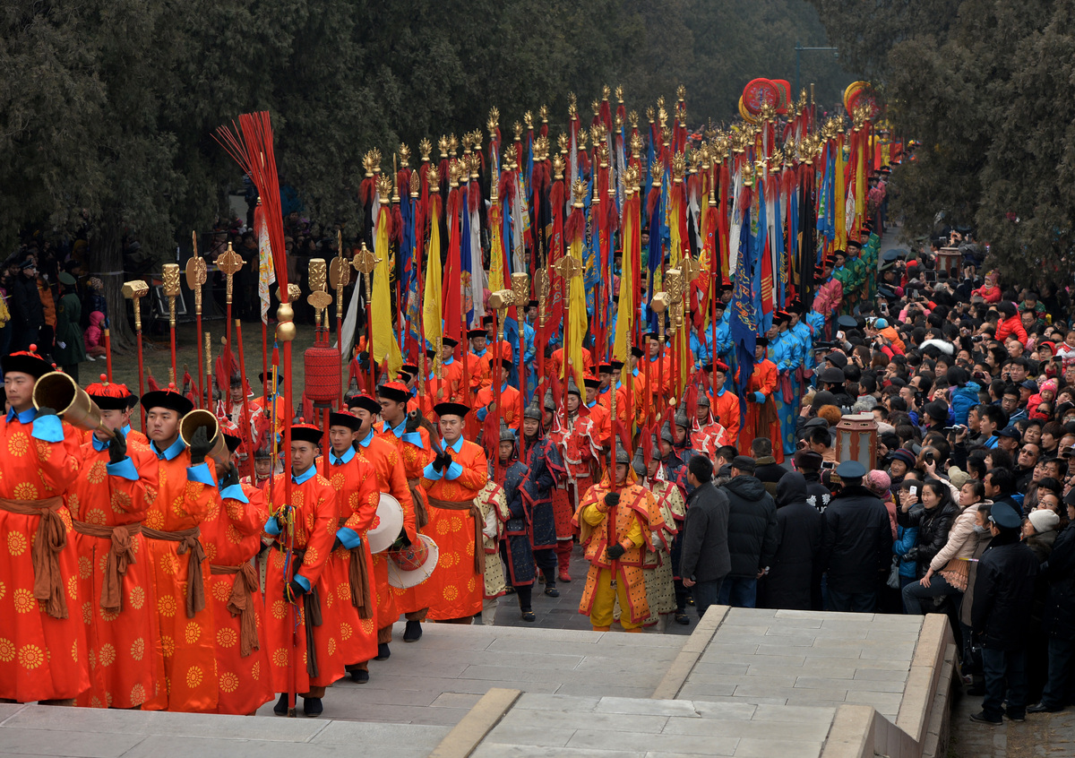 Chinese performers take part in a traditional Qing Dynasty ceremony in which emperors prayed for good fortune, during Lunar New Year festivities at the Temple of Heaven in Beijing on January 31, 2014. China welcomed in the Year of the Horse which sees about 3.62 billion trips made by Chinese travelers during the 40-day Spring Festival travel period. AFP PHOTO/Mark RALSTON (Photo credit should read MARK RALSTON/AFP/Getty Images)