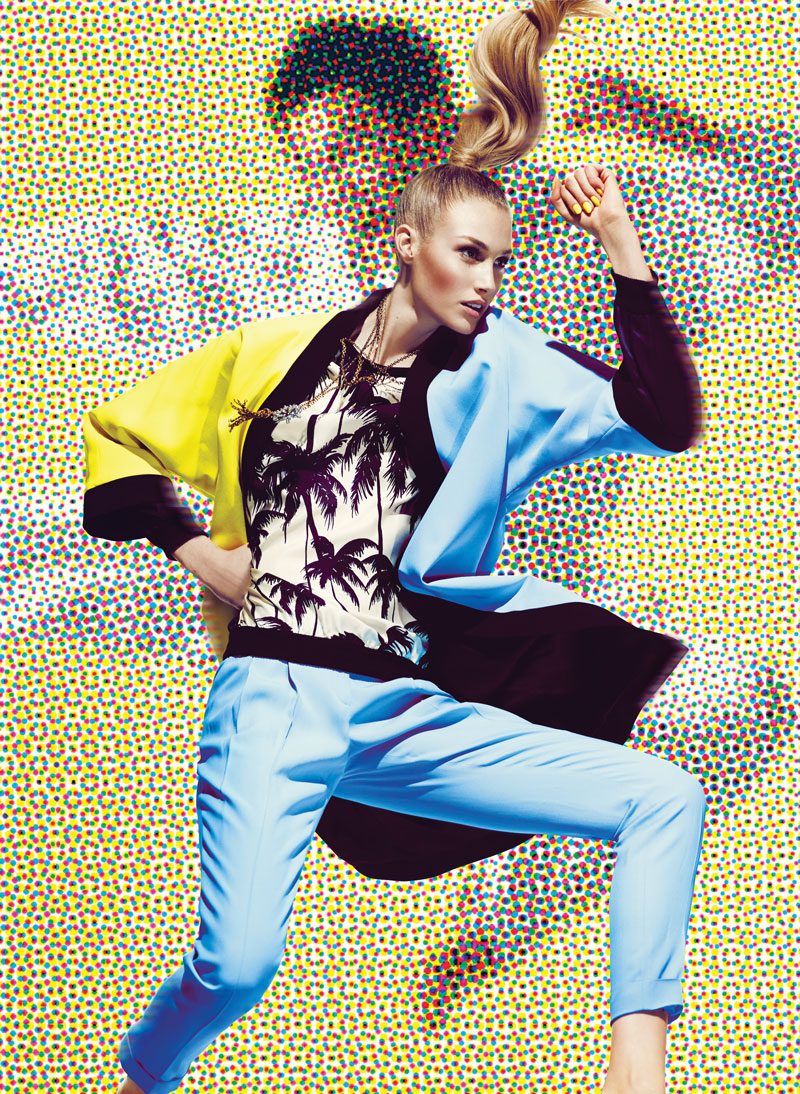 Jacket, $2,045, top, $1,225, and pants, $945, all by Fausto Puglisi. Necklace, $350, by Lulu Frost.