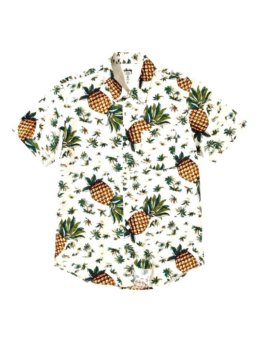 DELUXE MEN'S PINEAPPLE SHIRT  Covered in an island inspired print featuring artistic pineapples and palms, the classic cut short sleeve button down is crafted from 100% premium cotton poplin and includes a chest pocket.