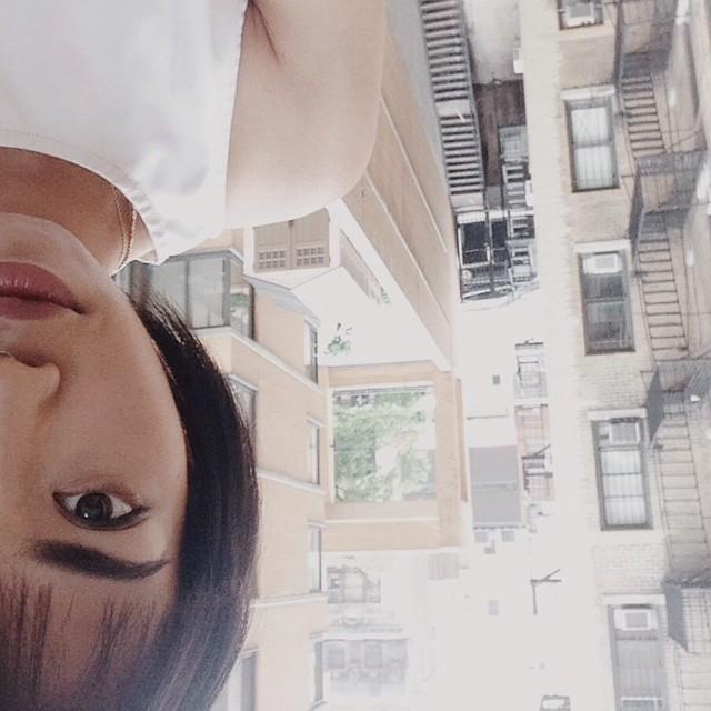 Loretta's upside down balcony/fire escape half selfie.