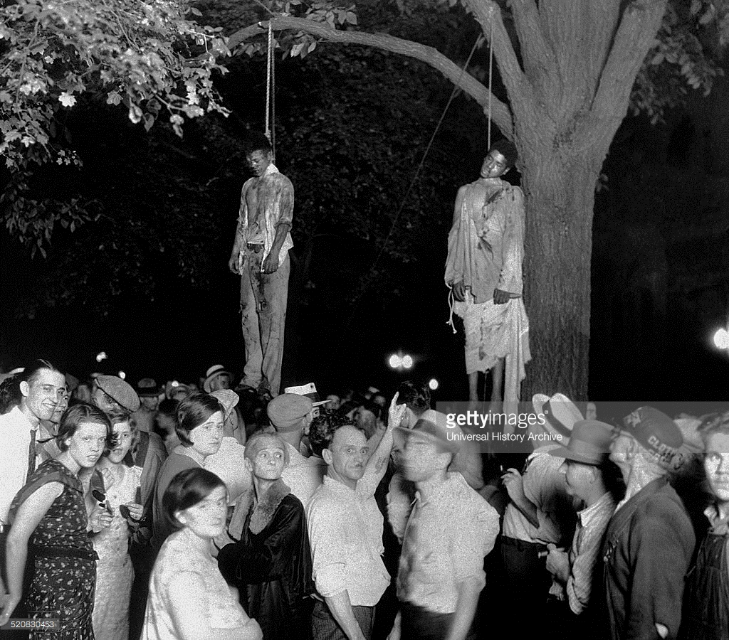 whose family members are these, gathers around this tree's strange fruit?