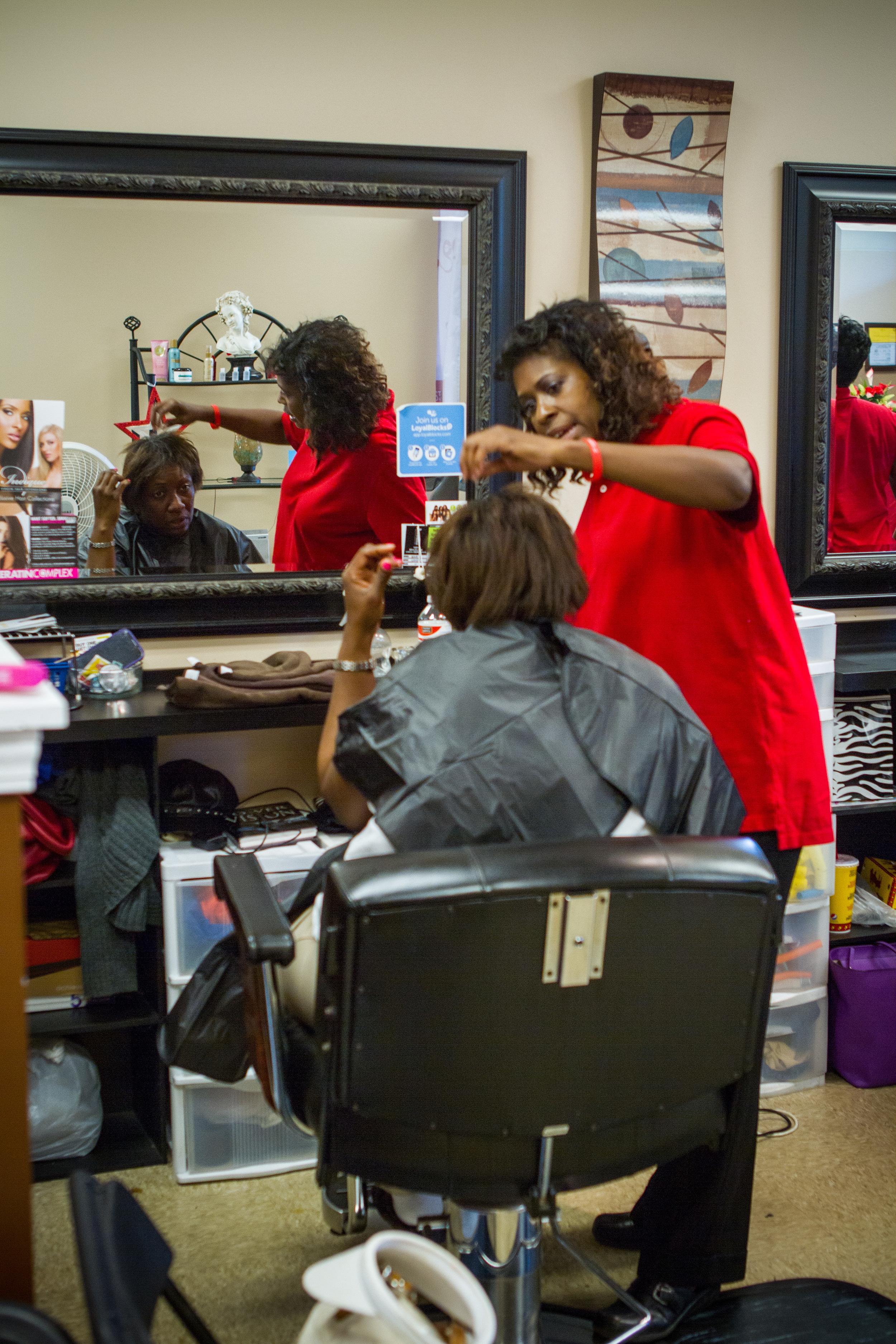 Stylist Donna assisting homeless participant.jpg