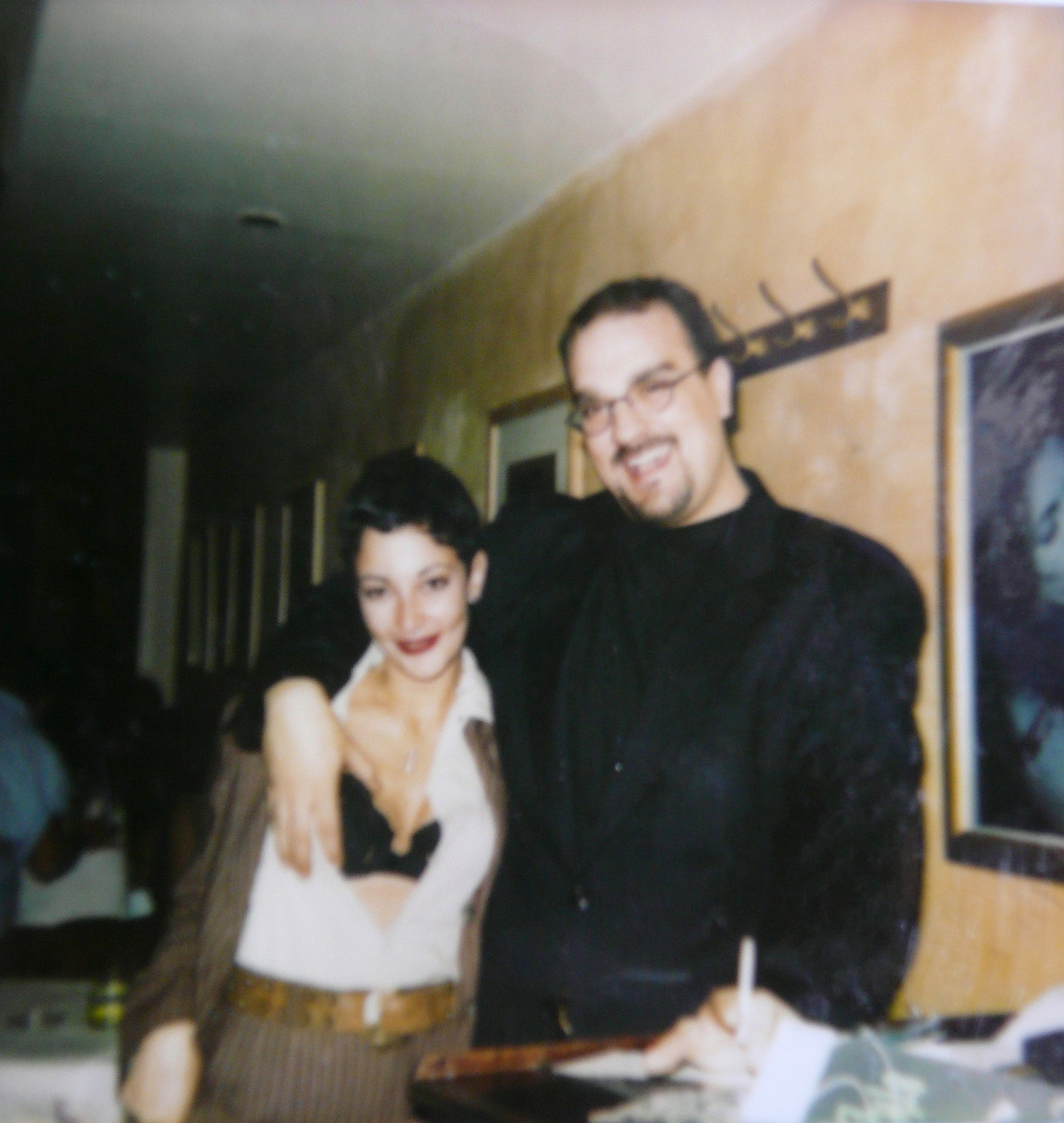 """""""Event co-creator Wanda and restaurant manager Roy P. I am wearing the Italian pinned striped suit with sexy lingerie. We were all playing with the Male/female Butch/Femme fashion style of the '90's lesbian scene."""" - Wanda Acosta, 2018. Image courtesy of Wanda Acosta"""
