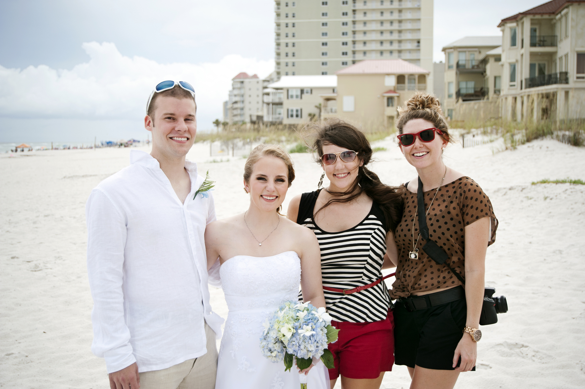 Brittany and I at our first wedding together on Gulf Shores Beach! Sarah and Tony look a lot more beautiful than us, but at least our first wedding is documented, haha.