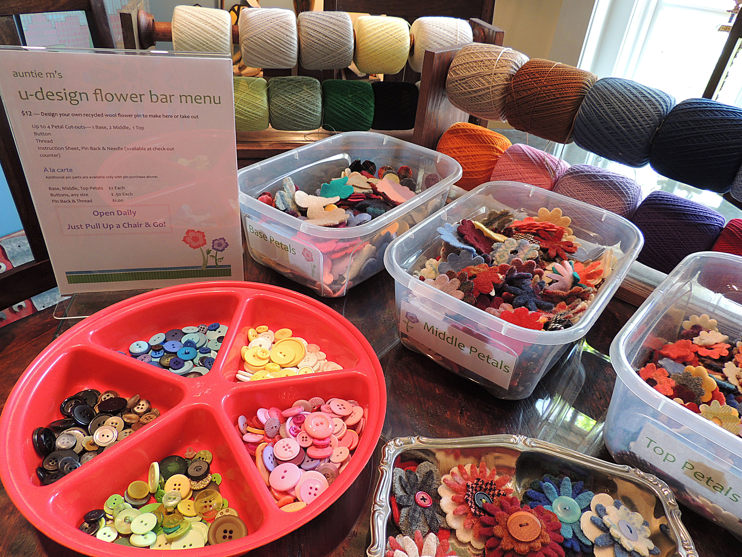 "Come design your own recycled flower pin at our ""always open"" Flower Bar. How fun!"