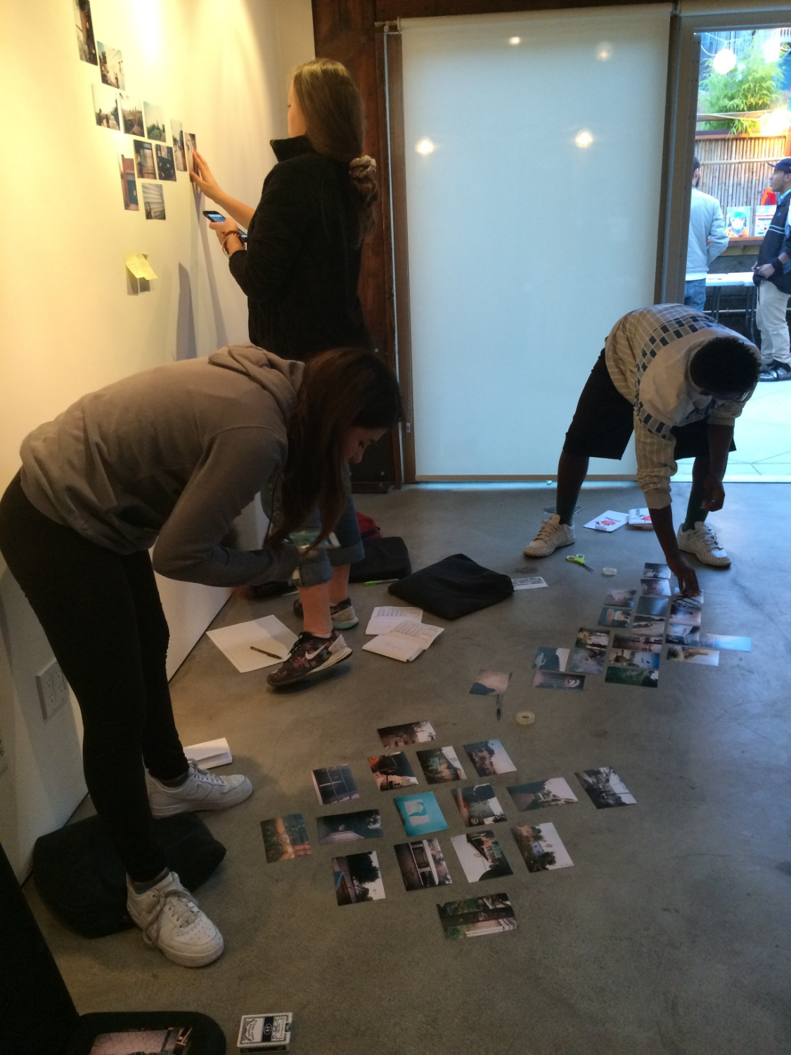 Sorting through the prints from their disposable camera photo project!