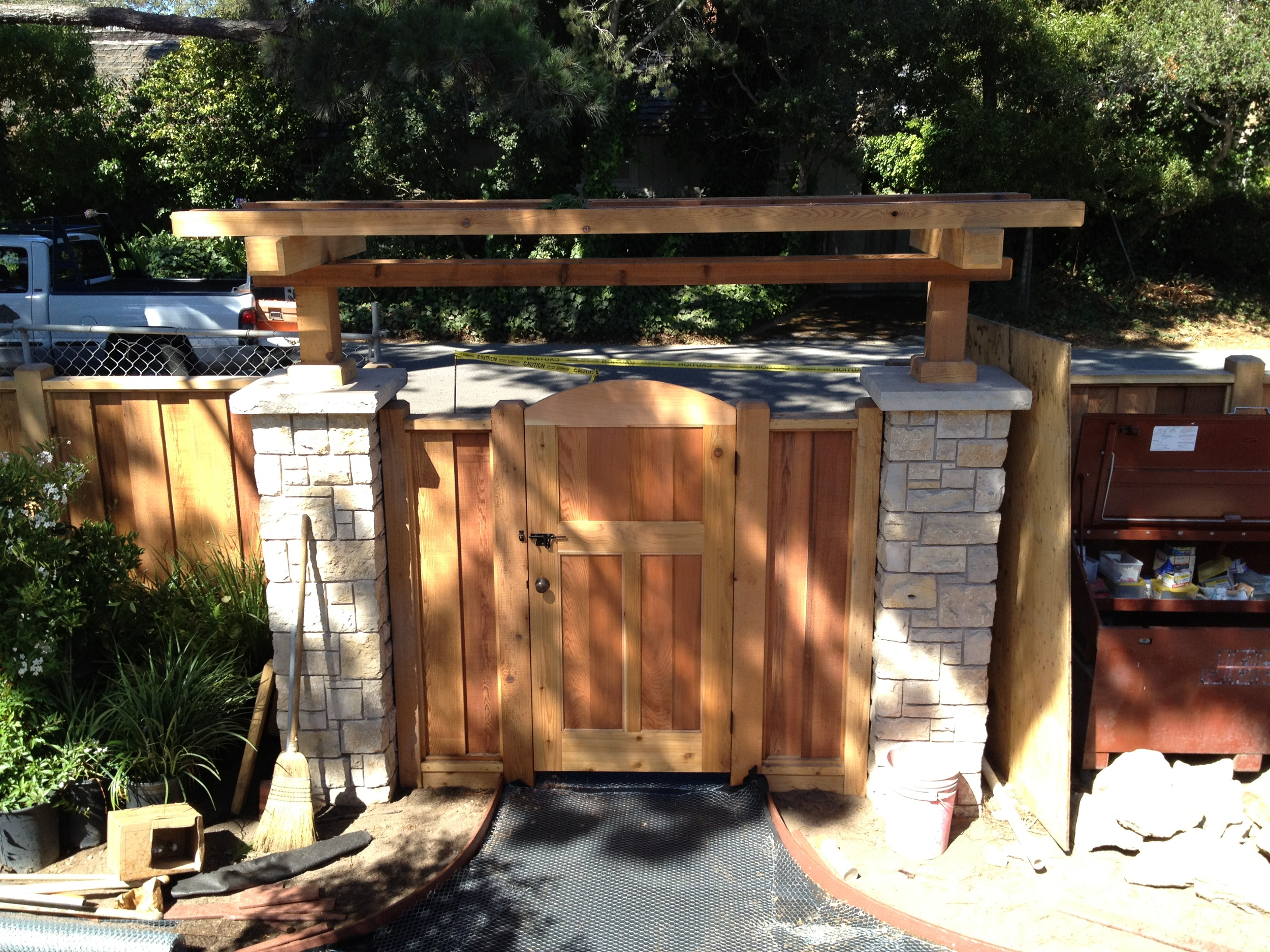 Entry gate in Cedar. It matches the front door in style.