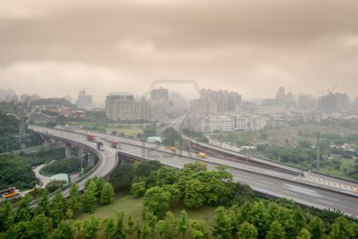 9410034-sunset-cityscape-of-highway-and-buildings-with-bad-weather-and-air-pollution-city-scenery-in-taipei-.jpg