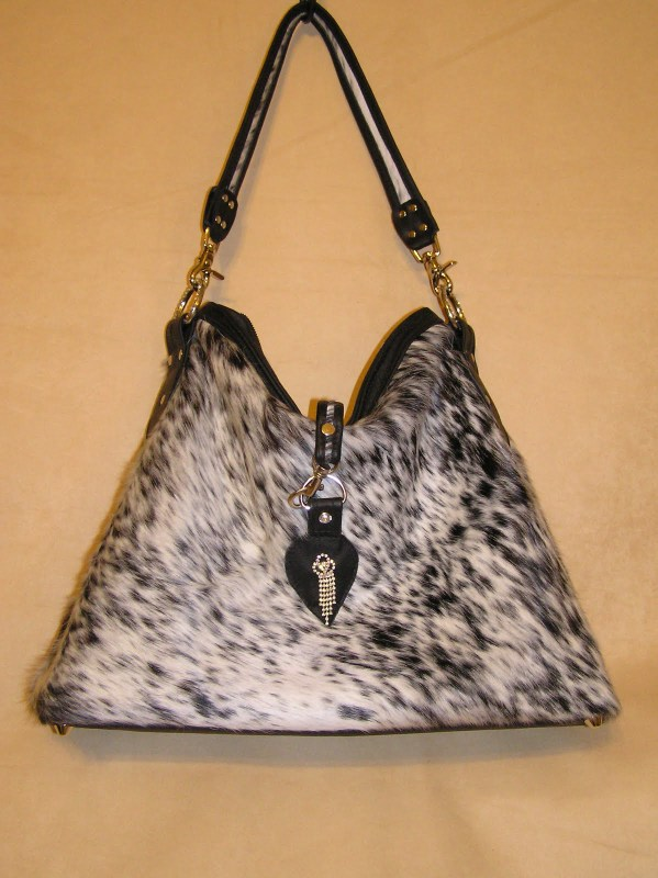 Black and White Fur on Cowhide with Black Leather Trim
