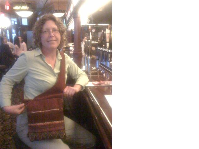 """Here I am at the Elephant and Castle Pub in Washington DC. Everyone loves the bag, so do I."""