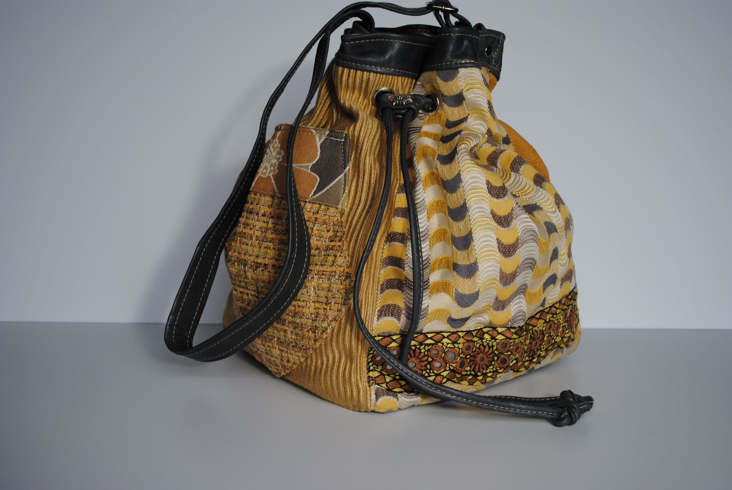 Discombobulated Yellow Tapestry Grey Leather and Mirror Embroidered Square Drawstring Batwa
