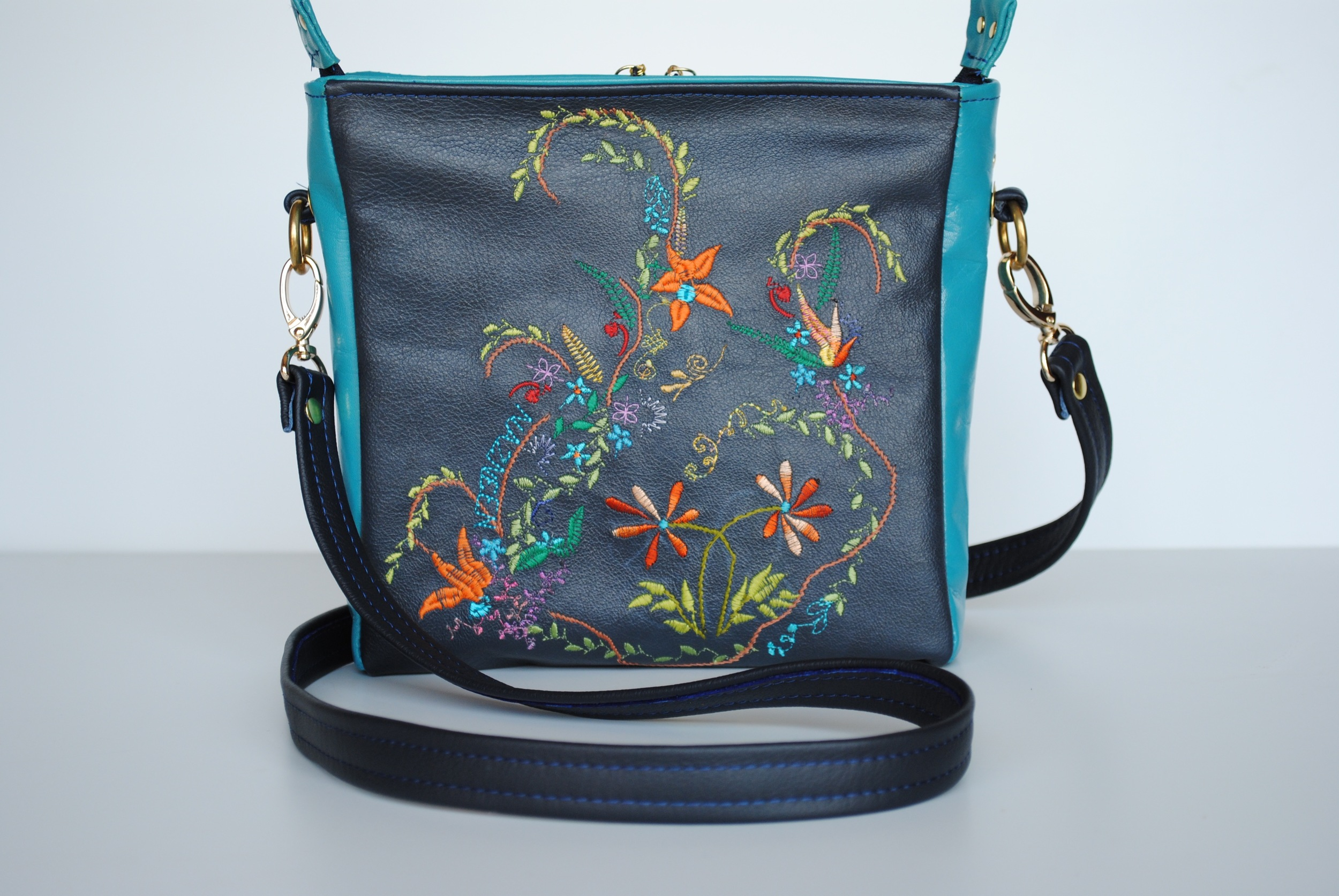 Sophisticated Garden Embroidered In Blue and Turquoise Leather Crossbody