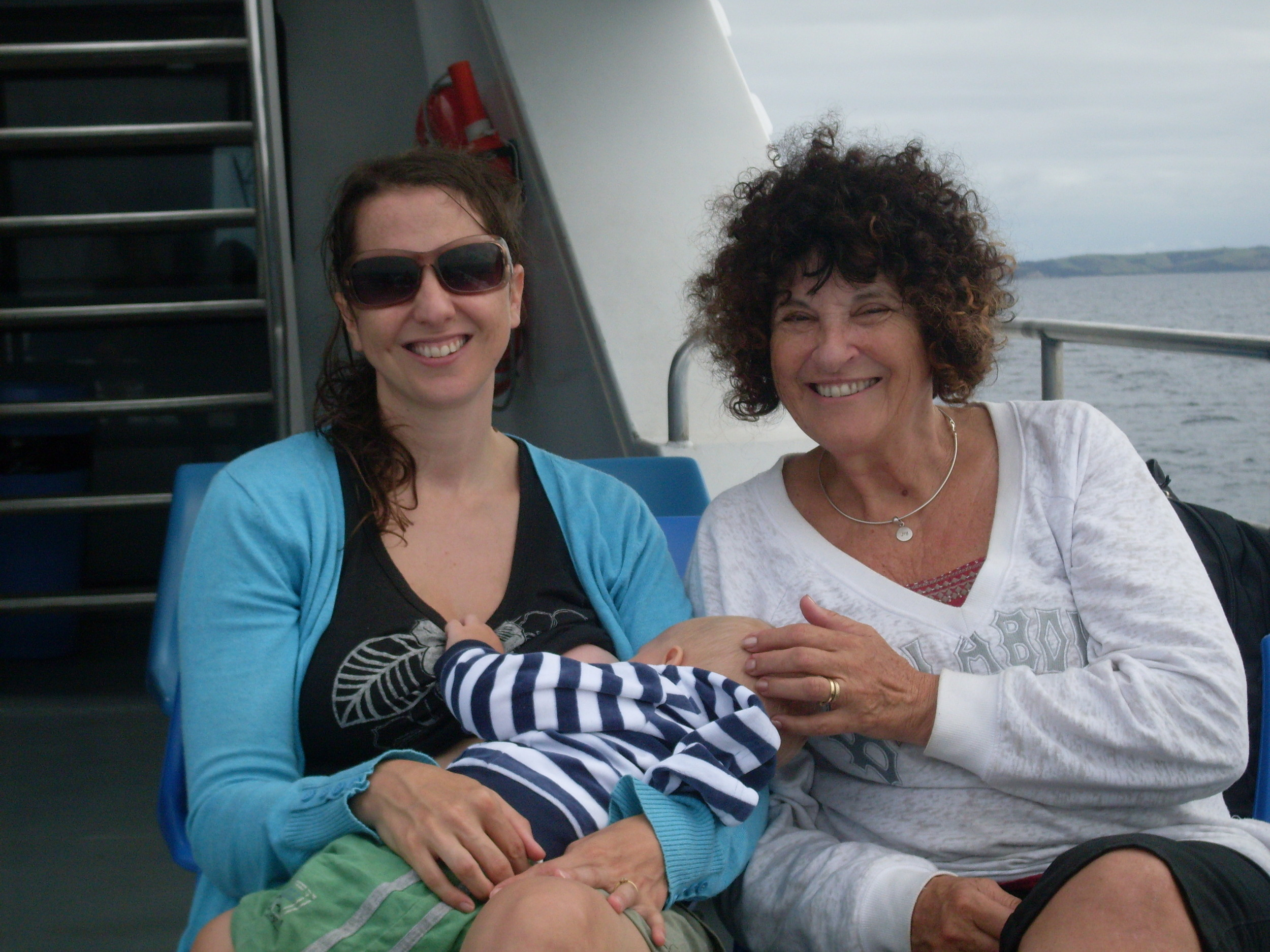 Breastfeeding aboard a fairy. With me in the photo is my mum, Gay.