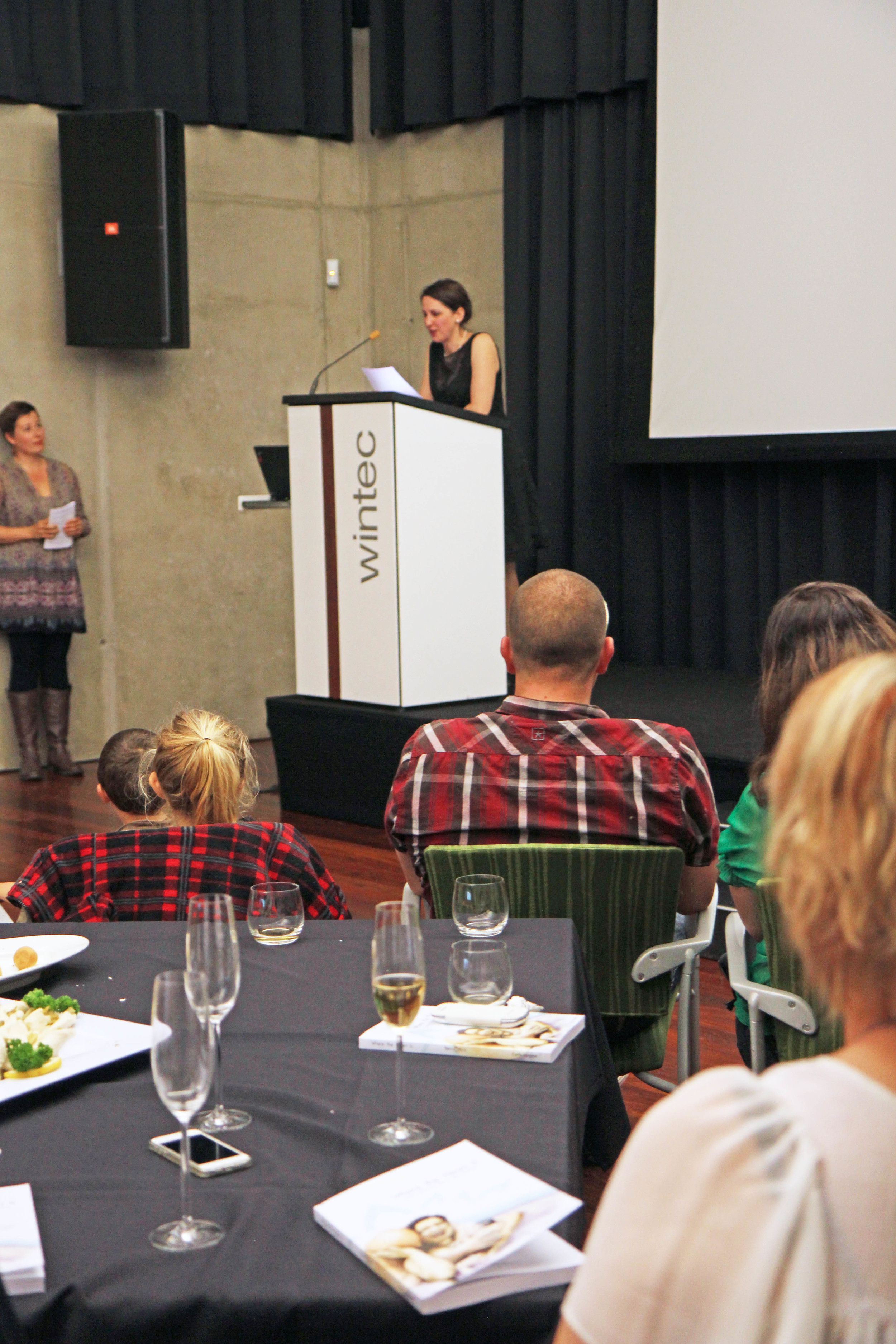 Me saying my speech. My amazing MC, Michelle, is to the left of the image.