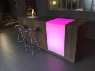 3form Chroma back lit with RGB LEDs reception desk