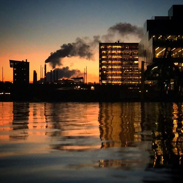 Copenhagen has a kickass skyline: An electric sky. Sapphire sea. Dynamic architecture. Industrial background. . #copenhagen #denmark #architecture #sunset