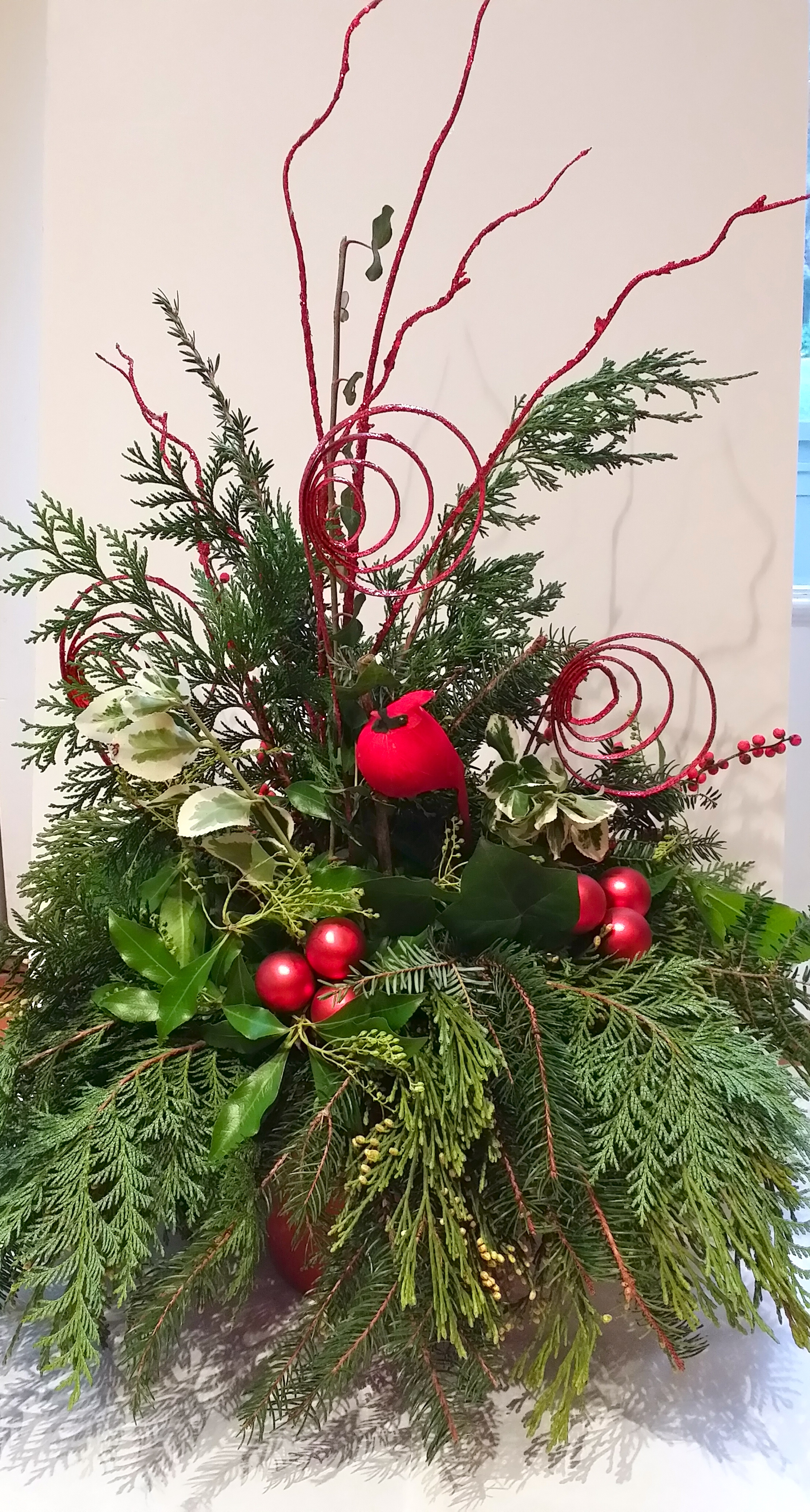 Brighten up any room with an arrangement of evergreens.