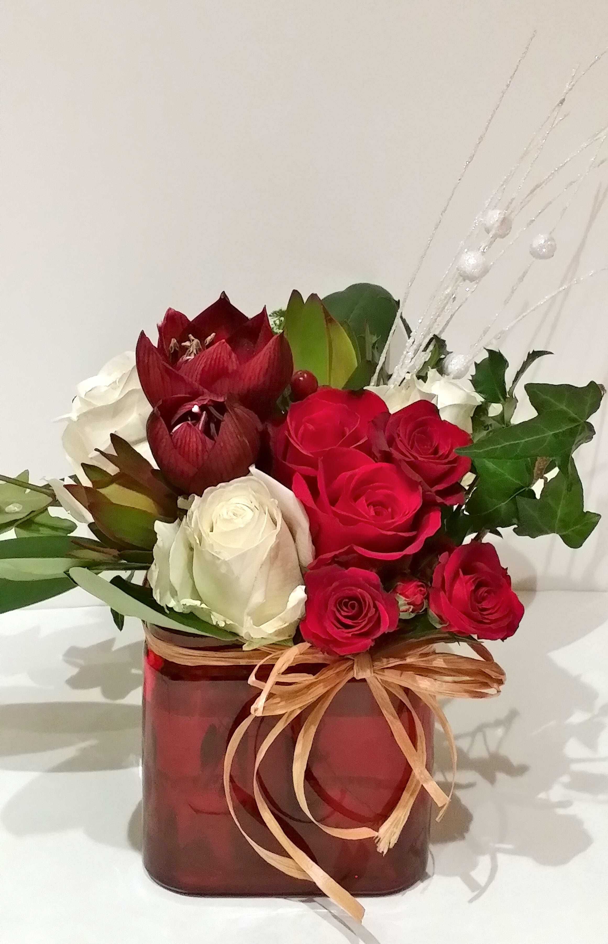 Red Amaryllis, white and Red Roses.