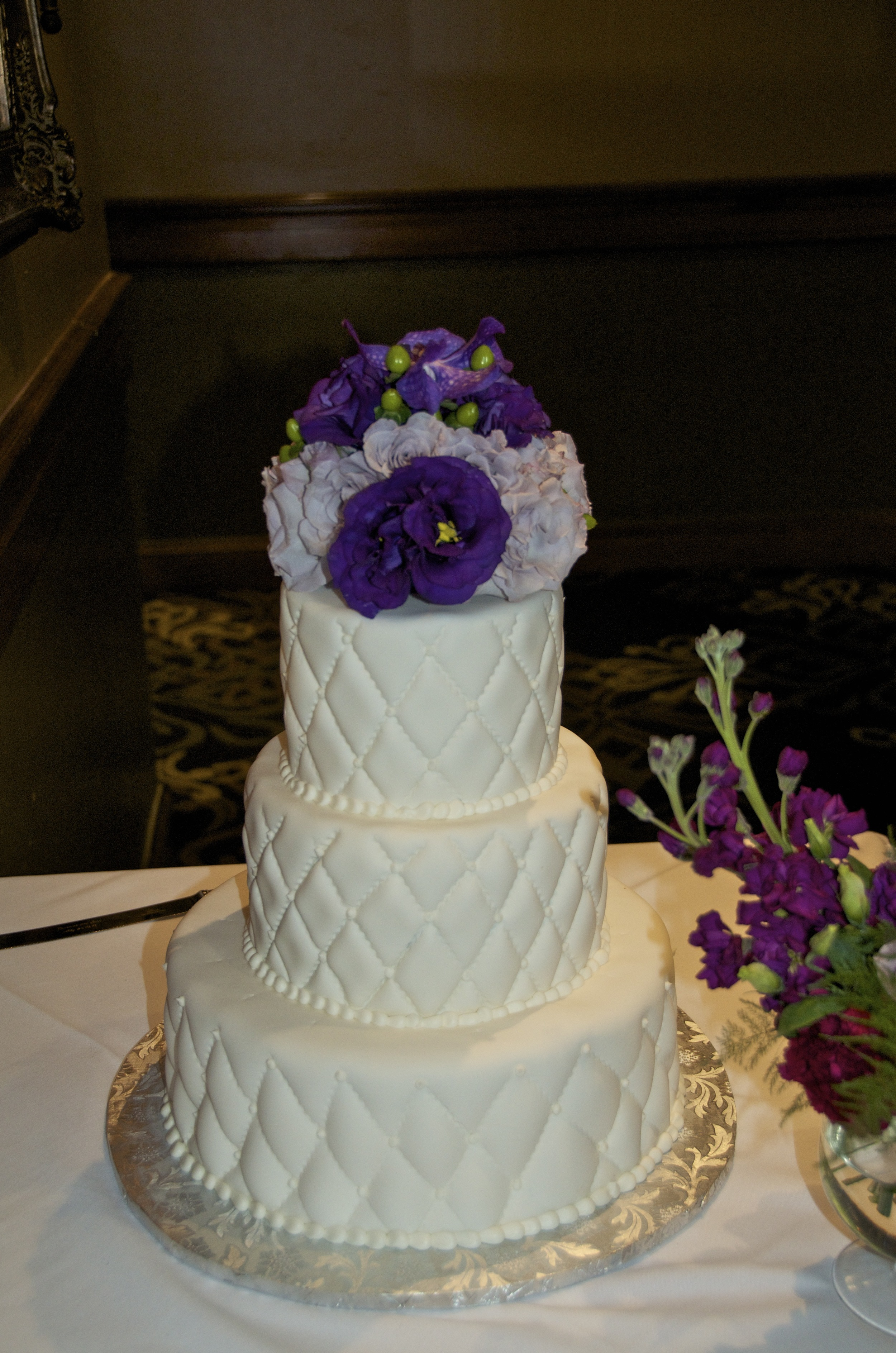 Cake topper made with fresh flowers.