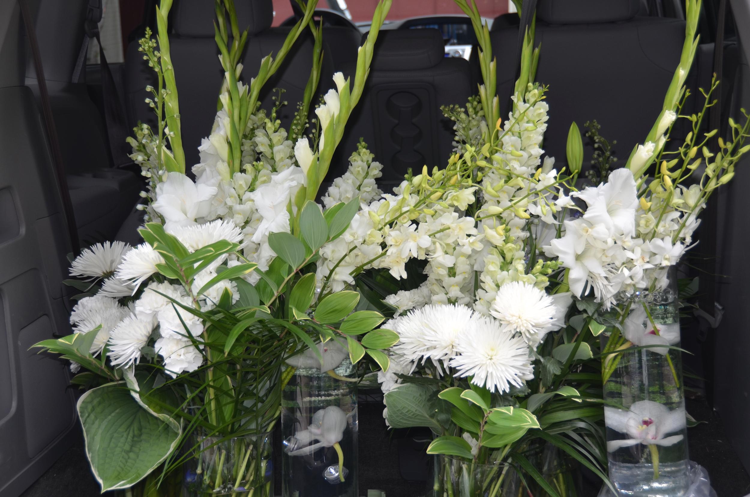 2015 wedding church flowers in trunk.jpg