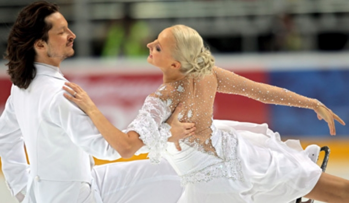 A Russian ice-skating pair offered a preview of Sochi 2014, including a pat-down as a security precaution.