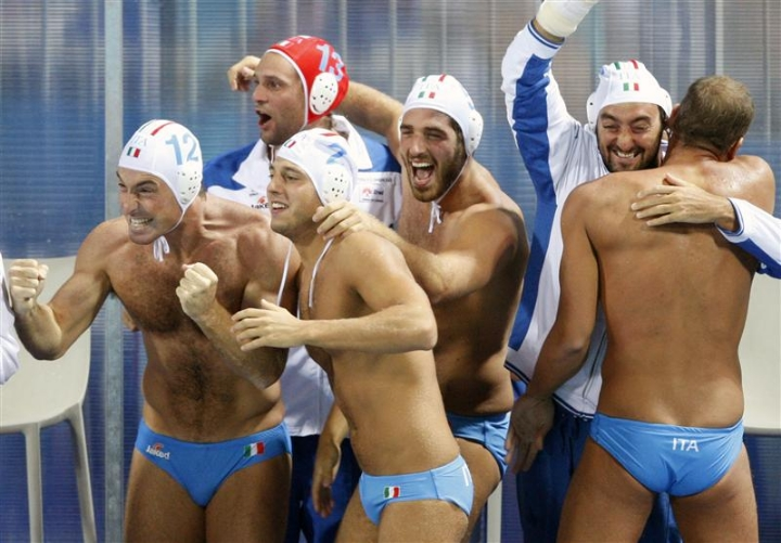 The Italian men's water polo team celebrates the attention they continue to receive because of their uniforms.