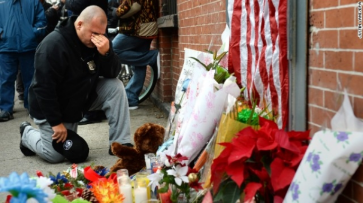 Two NYPD officers were shot dead, assassination-style, in their patrol car on December 20.  Photo: CNN.