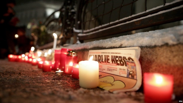"""A vigil in Vienna, Austria, for the victims of the Charlie Hebdo shooting in Paris, France, on January 7, 2015.    Photo: EPA, via BBC.        Normal   0           false   false   false     EN-US   X-NONE   X-NONE                                                                                                                                                                                                                                                                                                                                                                           /* Style Definitions */  table.MsoNormalTable {mso-style-name:""""Table Normal""""; mso-tstyle-rowband-size:0; mso-tstyle-colband-size:0; mso-style-noshow:yes; mso-style-priority:99; mso-style-parent:""""""""; mso-padding-alt:0in 5.4pt 0in 5.4pt; mso-para-margin-top:0in; mso-para-margin-right:0in; mso-para-margin-bottom:10.0pt; mso-para-margin-left:0in; line-height:115%; mso-pagination:widow-orphan; font-size:11.0pt; font-family:""""Calibri"""",""""sans-serif""""; mso-ascii-font-family:Calibri; mso-ascii-theme-font:minor-latin; mso-hansi-font-family:Calibri; mso-hansi-theme-font:minor-latin;}"""