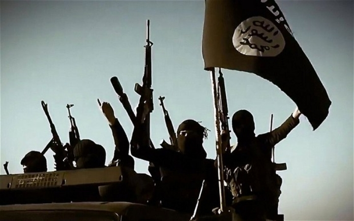 """Fighters with the Islamic State (ISIS) lift high their guns and raise their banner.    Photo: AFP/Getty (via    The Telegraph   ).           Normal   0           false   false   false     EN-US   X-NONE   X-NONE                                                                                                                                                                                                                                                                                                                                                                           /* Style Definitions */  table.MsoNormalTable {mso-style-name:""""Table Normal""""; mso-tstyle-rowband-size:0; mso-tstyle-colband-size:0; mso-style-noshow:yes; mso-style-priority:99; mso-style-parent:""""""""; mso-padding-alt:0in 5.4pt 0in 5.4pt; mso-para-margin-top:0in; mso-para-margin-right:0in; mso-para-margin-bottom:10.0pt; mso-para-margin-left:0in; line-height:115%; mso-pagination:widow-orphan; font-size:11.0pt; font-family:""""Calibri"""",""""sans-serif""""; mso-ascii-font-family:Calibri; mso-ascii-theme-font:minor-latin; mso-hansi-font-family:Calibri; mso-hansi-theme-font:minor-latin;}               Normal   0           false   false   false     EN-US   X-NONE   X-NONE                                                                                                                                                                                                                                                                                                                                                                           /* Style Definitions */  table.MsoNormalTable {mso-style-name:""""Table Normal""""; mso-tstyle-rowband-size:0; mso-tstyle-colband-size:0; mso-style-noshow:yes; mso-style-priority:99; mso-style-parent:""""""""; mso-padding-alt:0in 5.4pt 0in 5.4pt; mso-para-margin-top:0in; mso-para-margin-right:0in; mso-para-margin-bottom:10.0pt; mso-para-margin-left:0in; line-height:115%; mso-pagination:widow-orphan; font-size:11"""