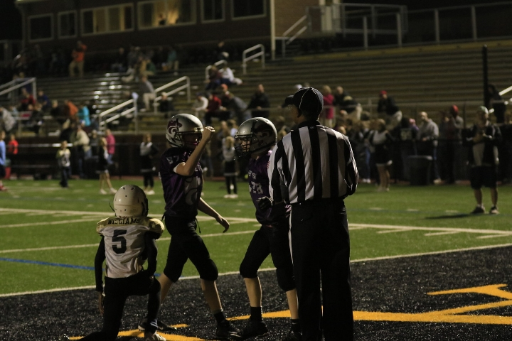 Camden (fist in the air) celebrates a teammate's touchdown catch right before halftime.