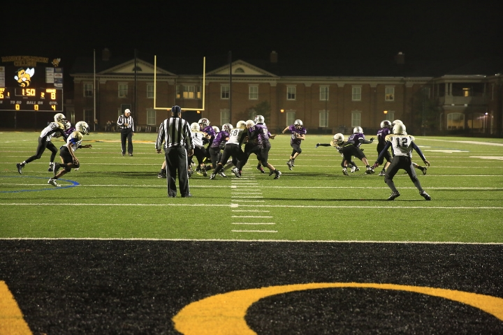 On 4th & 3, with less than two minutes to play in the fourth quarter, the Purple Cats create a huge hole for the running back. First Down.    Camden (furthest Purple Cat on the right) is doing his part to clear the way.