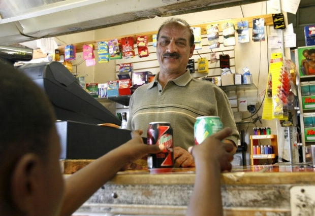 Mohammad Taib, behind the counter in his Food Mart store in Richmond, Va.    Photo: Kevin Morley/ Richmond Times-Dispatch  (2009).