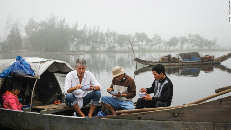 "Anthony Bourdain eats with fishermen in  Hue, Vietnam,  in 2014, while filming an episode for CNN's ""Parts Unknown.""    Photo: David Holloway/CNN."