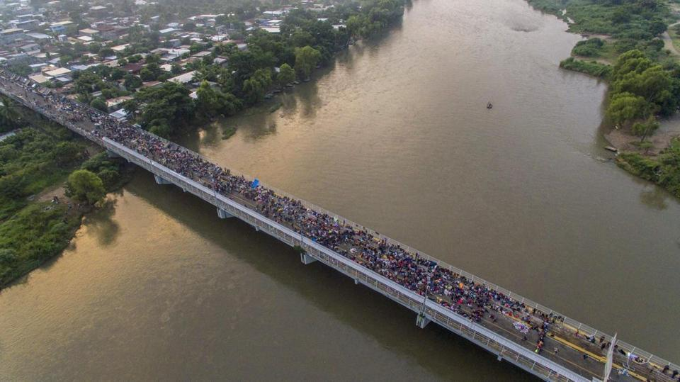 Honduran migrants get congested along the border bridge between Guatemala and Mexico.  Photo: The Boston Globe.