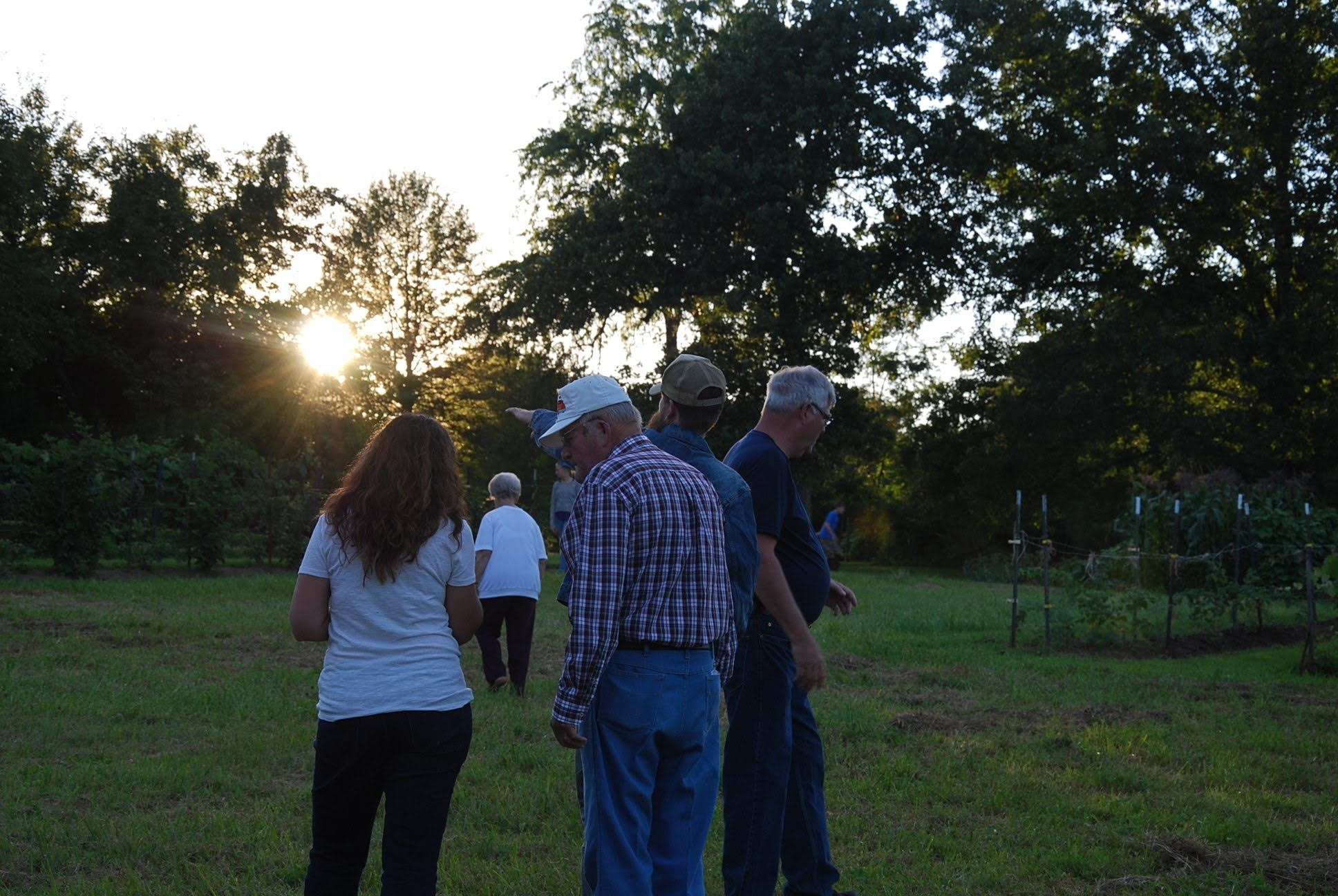 Grandpa Joe (white hat) faced his sunset in July 2019. Here, he's pictured on his land in Crossville, Tennessee.