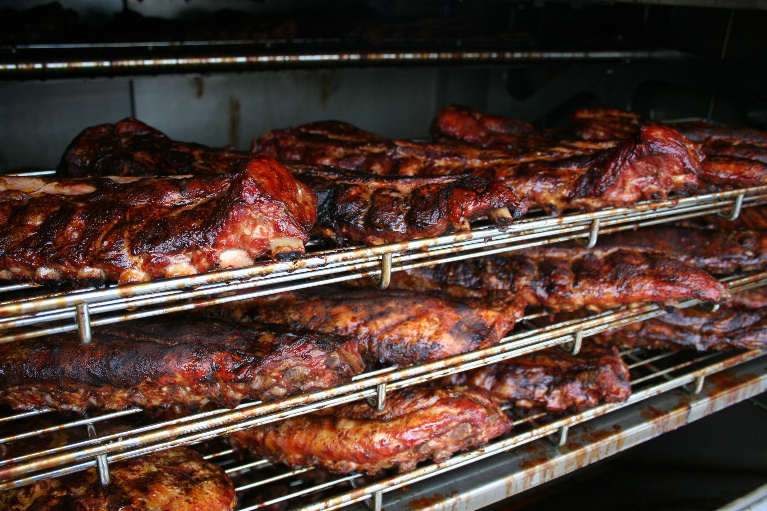 Tender ribs. Slow-smoked with hickory. Gotta make you smile!