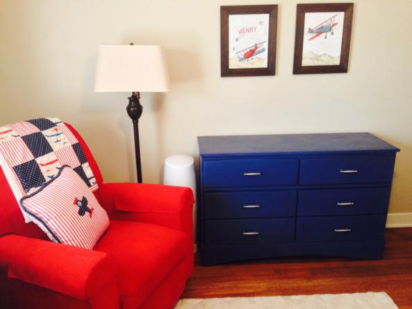 The navy dresser will also serve as a changing table as soon as they add the changing mat to the top of it.  The airplane pictures work perfectly in the room!