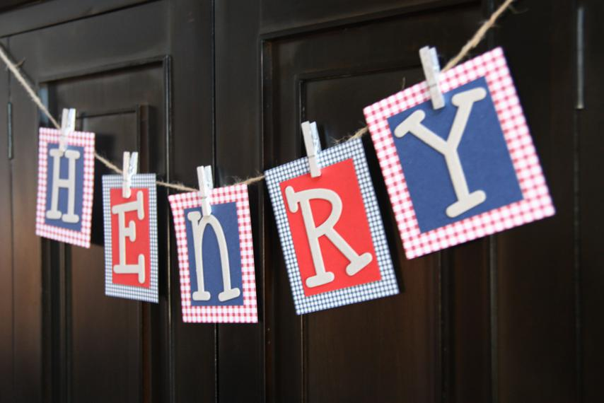 Easy peasy name banner made out of scrapbook paper.