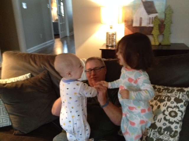 Jumping on Poppa - I can just hear the squeals of laughter in this picture!