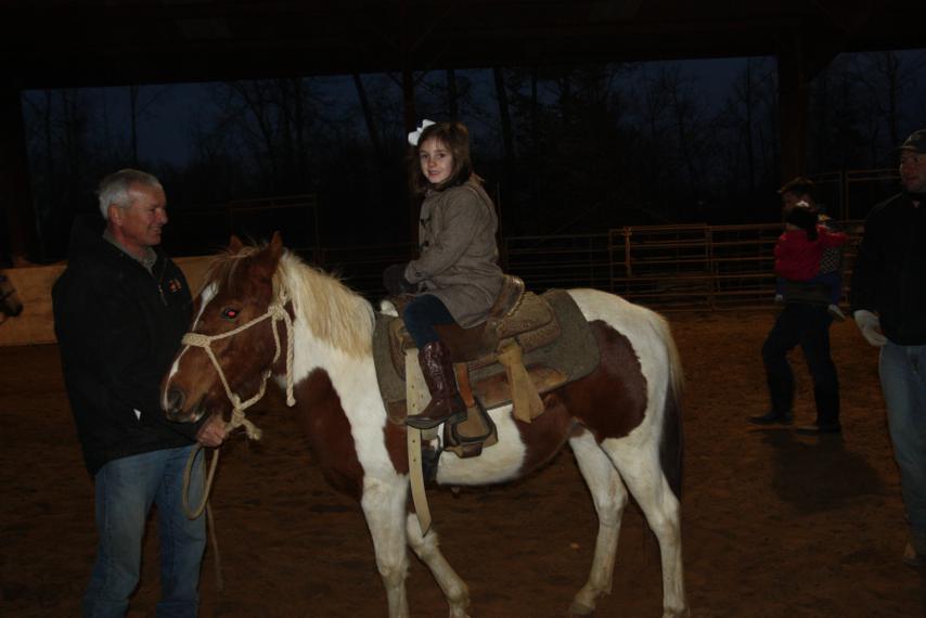 Brennie riding the pony by herself.