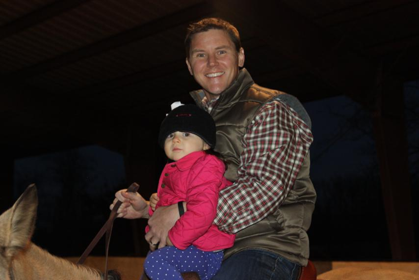 Katie Wynn riding with Daddy.