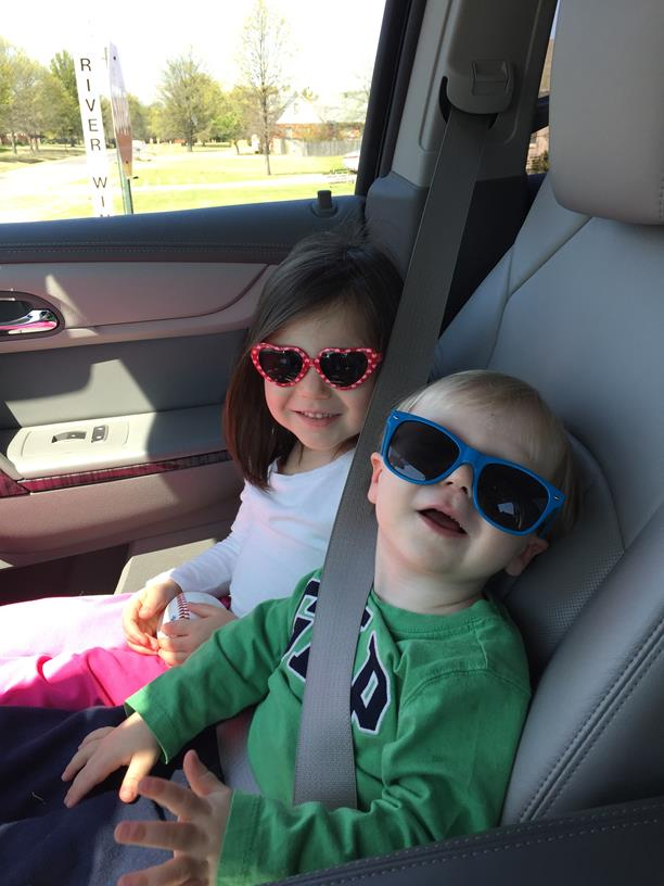 Riding shotgun in shades (don't worry, we just went around the corner!).